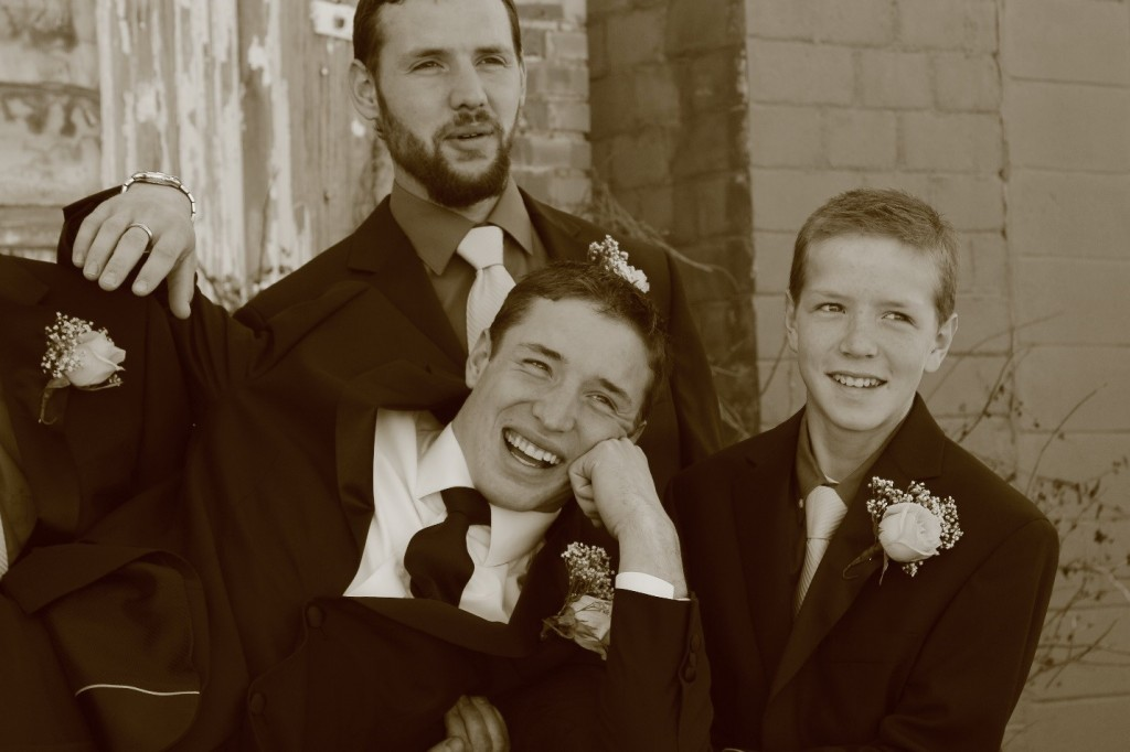 The groom being held by all his groomsmen.